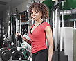 Exercise African American Woman Wearing A Red Doing Arm Exercises In The Gym stock photo