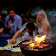 People Eating  flames grill chatting people fire sausages stock photography