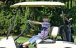 Stock Photo : Smiling Stock Photography: Boy in Golf Cart