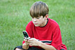 Children Boy Playing Game on Cell Phone stock photography