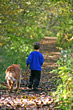 Boy Walking on Path with Dog