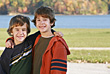 Boys in Front of the Lake in the Fall stock photo