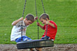 Stock Photo : Children Stock Photography: Boys on Tire Swing