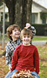 Stock Photo : Smiling Stock Photo: Boys Playing in the Leaves