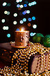 Burning Candle And Seasonal Decorations On Bokeh Lights Background stock photography