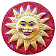 Ceramic Adornment Red Sun Smiles On Red Background stock photography
