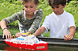 Stock Photo : Children Stock Image: Children Playing With Boat