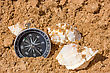 Compass And Seashells In The Beach Sand stock photography