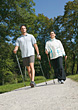 Exercise Couple Doing Nordic Walking Exercise stock photo