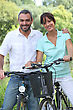 Couple Riding Bikes stock photography