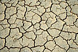 Stock Photo : Erosion Stock Photo: Cracks In The Parched Earth Of The Steppe.