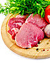 Stock Photo : Cut Stock Photography: Cuts Of Meat, Garlic, Tomatoes, Parsley, Dill On A Round Wooden Board