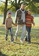 Stock Photo : Kid Pictures: Dad and Kids Walking in Park