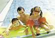 Stock Photo : Kid Stock Image: Dad with Kids in Pool