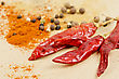 Stock Photo : Aromatic Pictures: Dried Peppers And Other Kind Of Peppers Spices On A Brown Background
