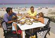 Family Dinner on Beach Vacation stock photo