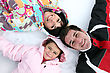 Joyful Family Laying In The Snow stock image
