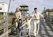 Families Family Walking on Boardwalk - stock image