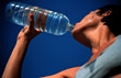 Exercise Female Athlete Drinking Water Bottle stock photo