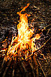 Myths Fire Flames With Reflection On Black Background stock photo