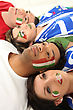 Four Italian Soccer Fans Laying On The Floor stock photography