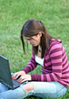 Stock Photo : Learning Stock Photo: Girl working on Laptop in Grass