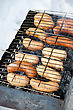 Stock Photo : Grill Pictures: Grilled Sausages On Grill, With Smoke Above It