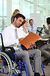 Group Of Business People In A Meeting Room, One Of Them In A Wheelchair. stock image