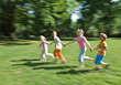 Stock Photo : Groups Small Stock Photography: Group of Friends Running Across Grass