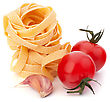 Italian Pasta Fettuccine Nest And Cherry Tomato Isolated On White Background stock image