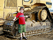 Stock Photo : Children Stock Image: Little Boy Leaning on Bulldozer