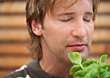 Stock Photo : Herb Stock Photo: Man Smelling Herbs With Eyes Closed