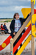 Stock Photo : Baltic Sea Pictures: Mature Woman Relaxing In Dune At The Baltic Sea In Autumn Day