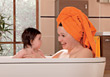 Stock Photo : Children Pictures: Mom and Baby Taking a Bath