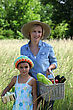 Mother And Daughter Carrying Baskets stock photography