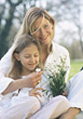 Mother with Daughter Smelling Flowers stock photo