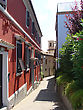 Narrow European Street With The Red House Italy stock photography