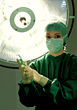 Nurse With Surgical Mask Holding Syringe
