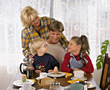 People Eating  parents happy family breakfast eating happiness stock photo