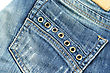 Pocket on back of jeans trousers. - stock photo