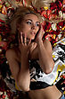 Blond Pictures: Portrait Of Charming Young Woman Lying In Rose Petals