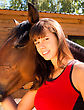 Outside Portrait Of The Beautiful Girl With A Horse stock image