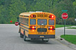 Stock Photo : Children Pictures: School Bus Breaking for Stop