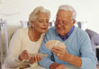 Senior Couple Playing Cards stock photo