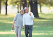 Stock Photo : Seniors Pictures: Senior Couple Walking In The Park