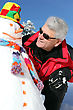 Stock Photo : Mature Pictures: Senior Man With A Snowman