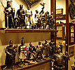 Shield Shelf In Antiquities Shop With Metal Medieval Crusades Knight Soldiers. stock image