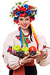 Smiling Young Woman In The Ukrainian National Clothes With Fruit stock photo