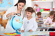 Teacher, Pupil, Reading, Globe - stock photo