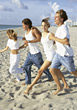 Stock Photo : Beach Stock Photography: Teenagers Running to the Beach